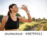 sporty young woman drinking... | Shutterstock . vector #448795411