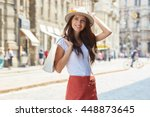 woman holding shopping bags... | Shutterstock . vector #448873645