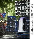 Small photo of NEW YORK - JUNE 12 2016: A van modified with dozens of speakers amplify music to celebrate the 59th annual National Puerto Rican Day Parade along 5th Avenue in New York City on June 12 2016.