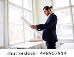 confident architect holding... | Shutterstock . vector #448907914