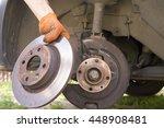 man holds brake disc of the car ... | Shutterstock . vector #448908481