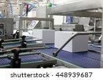 cardboard boxes on conveyor... | Shutterstock . vector #448939687
