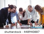 editors looking at photos on... | Shutterstock . vector #448940887