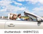 happy couple driving in... | Shutterstock . vector #448947211