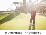 sportsman playing golf on a... | Shutterstock . vector #448958959