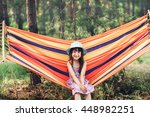 girl resting on a hammock in... | Shutterstock . vector #448982251