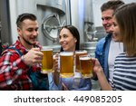 happy brewers toasting beers at ... | Shutterstock . vector #449085205