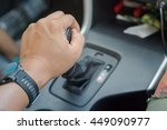 man driver hand shifting the...   Shutterstock . vector #449090977