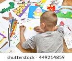 little boy draws on a piece of... | Shutterstock . vector #449214859