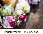 Frozen Flowers In Ice Cubes On...