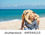 beautiful young woman hugs her... | Shutterstock . vector #449544115