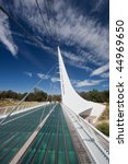 Sundial Bridge is a cantilever spar cable-stayed bridge for bicycles and pedestrians that spans the Sacramento River in Redding, California - stock photo