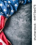 Small photo of USA flag. American flag. American flag freely lying on concrete background. Close-up Studio shot. Toned Photo.