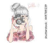Hand drawn beautiful cute girl in a floral dress with camera in his hands. Vector illustration. | Shutterstock vector #449789239