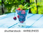 Glass With Ripe Cherry And...