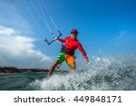 a kite surfer rides the waves | Shutterstock . vector #449848171
