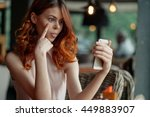 red haired girl   telephone ...   Shutterstock . vector #449883907