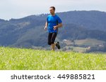 man running at mountain... | Shutterstock . vector #449885821