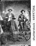 Two men on high wheel  boneshaker bicycles Penny Farthing 1880s, Vintage black and white tintype - stock photo