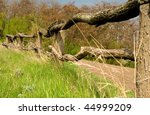 Old Wooden Fence On A Green...