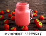 strawberry smoothie in jar... | Shutterstock . vector #449995261