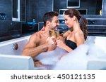 beautiful young couple relaxing ... | Shutterstock . vector #450121135