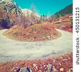 Small photo of Abrupt Bend in the Asphalt Road in the Italian Alps, Retro Effect