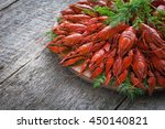 boiled crayfish with dill. | Shutterstock . vector #450140821