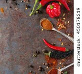 Small photo of Spicy background with assortment of different hot chili and allspice peppers over old rusty iron background. Top view. With copy space. Square image