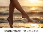 sexy woman's legs  on the sandy ... | Shutterstock . vector #450213511