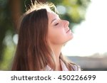 young happy smiling woman doing ... | Shutterstock . vector #450226699