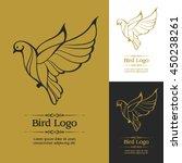 gold and black bird logo icon.... | Shutterstock .eps vector #450238261