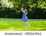 cute little girl playing in... | Shutterstock . vector #450261961