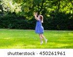 cute little girl playing in...   Shutterstock . vector #450261961