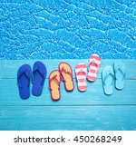 thongs on the blue planks... | Shutterstock . vector #450268249