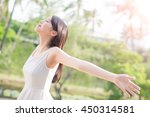 young woman raising her arms... | Shutterstock . vector #450314581