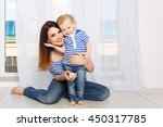 young mother and baby daughter... | Shutterstock . vector #450317785