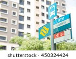 bus stop in singapore said a... | Shutterstock . vector #450324424