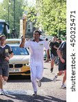 A Torchbearer During The...