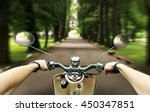 man is riding on the scooter in ... | Shutterstock . vector #450347851