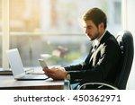 man using laptop and smart... | Shutterstock . vector #450362971