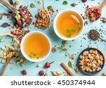 two cups of healthy herbal tea... | Shutterstock . vector #450374944