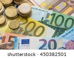 euro banknotes and coins | Shutterstock . vector #450382501