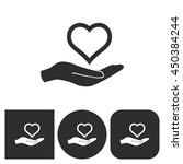 heart in hand   black and white ... | Shutterstock .eps vector #450384244