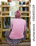 Small photo of wooden loom with weaver - Turkey