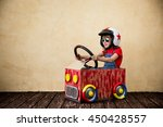 child driving a car made of... | Shutterstock . vector #450428557