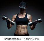 athletic woman pumping up...   Shutterstock . vector #450448441