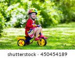 Cute girl wearing safety helmet ...
