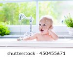 baby taking bath in kitchen... | Shutterstock . vector #450455671