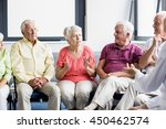 seniors and nurse talking to... | Shutterstock . vector #450462574